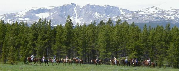 Horseback Riding under the shadows of the Big Horn Mountains in Wyoming